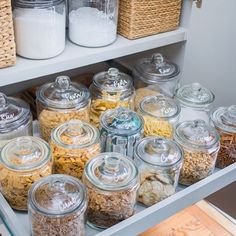 A pull out pantry shelf displays a collection of clear glass jars characterizing each snack with white lettering labels. Kitchen Organization Pantry, Home Organisation, Pantry Storage, Organizing Ideas, Organization Hacks, Organized Pantry, Organising, Pantry Diy, College Organization