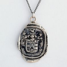 """Pyrrha's Omnia Vincit Amor (""""Love Conquers All"""") Wax Seal Necklace. Cast in reclaimed silver from a 19th century wax seal. $166"""