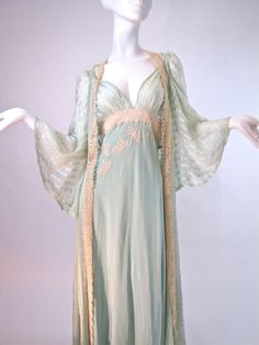 Heirloom Vintage 30's Bridal Trousseau Rococo style heirloom bridal trousseau dates from 1933-1940.  Color: aqua pastel Open back and neckline; French braided shoulder straps and a French made needle run lace band across the bodice. Sweeping full skirt. The lavish trained robe employs sheer aqua silk crepe accompanied by finely gossamer silk ribbon stripes. Silk covered buttons down the front bodice, belle sleeves, and French lace for the trimming. Hand stitched and of the finest quality.