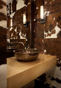 """""""Rowland+Broughton used magnetic cowhide wall tiles combined with a simple wood vanity top and a solid bonze Ann Sacks sink to create a modern rustic Powder Room."""" -- Magnetic cowhide wall tiles????"""