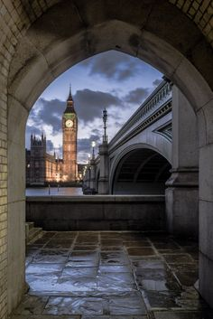 An early evening photo of Big Ben (the Elizabeth Tower), framed by a nearby archway just off of Westminster Bridge, London, UK Magic Places, Places To Visit, Places Around The World, Around The Worlds, Westminster Bridge, Westminster Abbey, Voyager Loin, England And Scotland, London Photography