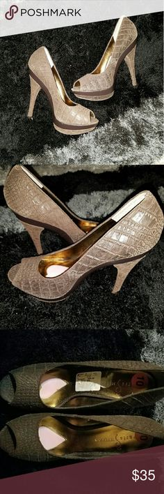 Paris Hilton Platform Heels This listing offers a new without tags authentic pair of Paris Hilton Platform heels.   Details:            ? Size 10M           ? MSRP: $99           ? Brown faux alligator leather ????????? ? Color: Brown   ? ALL OFFERS ARE WELCOME ?? ? Happy Buying ? Paris Hilton Shoes Heels