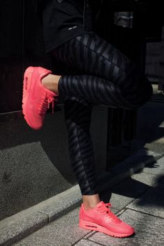 Black striped leggings w/ bright pink shoes
