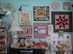 I have done this with mini quilts in my quilt room too - love it!