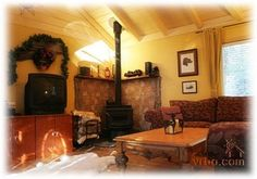 Corner wood stove and beamed ceiling