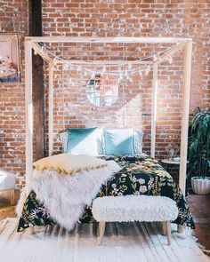 Urban Outfitters bedroom shop the look Plum Bow Tassel Garland