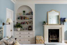 Master bedroom. Antique brass wall lights, mirror from OKA, walls painted in Farrow & Ball Parma Gray.