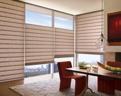Enhance the warmth of this exquisite dining room setting with the beauty and energy efficiency of Vignette® Modern Roman Shades ♦ Hunter Douglas window treatments