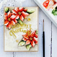 Watercolored poinsettias by Debby Hughes.