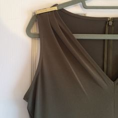 MK sleeveless dress This dress is stunning! V neck style with gold detailing on shoulders. Great for a spring or summer wedding!! Army green color, zipper on back. Made of polyester and elastane. New with tags and never worn. Michael Kors Dresses