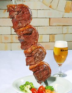Typical Brazilian churrasco. The top sirloin cap (culotte or coutlotte) is called Picanha and is served grilled over open flames, and is one of the meat cuts in the rodizio style restaurants, where it is common to roast the whole piece and then served in slices from it as thin or thick as desired.