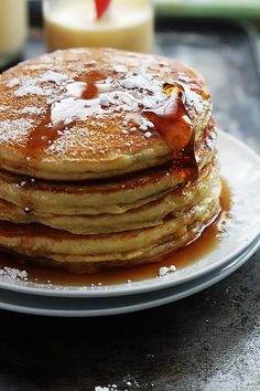 Eggnog Pancakes - Easy, fluffy eggnog pancakes topped with syrup and powdered sugar. What's For Breakfast, Breakfast Pancakes, Christmas Breakfast, Breakfast Dishes, Breakfast Recipes, Dessert Recipes, Pancakes Easy, Pancake Recipes, Christmas Morning