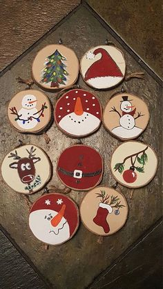 Various painted wood slice ornaments that include snowmen, stockings, deer and trees - 25 Rustic Wood Slice Christmas Decor Ideas