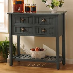 """Get the perfect, quaint winter look this season with pieces like our """"Blue Beadboard 4-Drawer Console Table."""" This vintage blue item will give any room the look of a country farmhouse in addition to providing functionality and storage! We especially love the brass cup drawer pulls."""