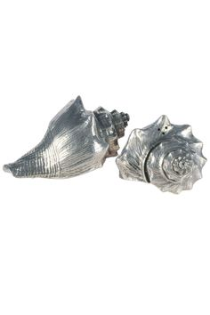 "Given a beautiful conch shell, the first thing most people will do is hold it to their ear to hear the song of the sea. Although we can't claim that will happen with the pure pewter Conch Shell Salt and Pepper Set, we can say that this set will bring some of that magic to your table when you serve with it. 2.5"" L x 3.75"" W x 2"" H   Shell Salt & Pepper Shaker by Vagabond House. Home & Gifts - Home Decor - Dining - Table Accessories New Hampshire"