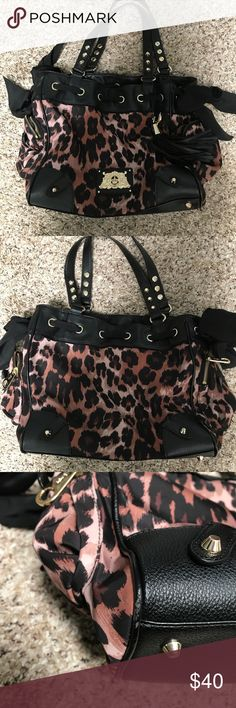 Leopard cheetah nylon Malibu Daydreamer Tote EUC Carries so much stuff! I definitely used this as an overnight bag on several occasions, with room to spare! Shiny gold hardware and faux leather trim. Hardware looks good with no tarnishing, and slight wear around bottom edge of bag and straps. Inside is very clean. Measures about 13 inches across not including the side pockets. Measures about 10 inches tall and 6 inches deep. 10 inch strap drop. Magnetic snap closure with zippered pocket on…