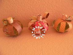 Paper craft Pumpkins with wine cork stems.