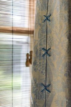 exquisite drapery detail layered over natural woven wood shade