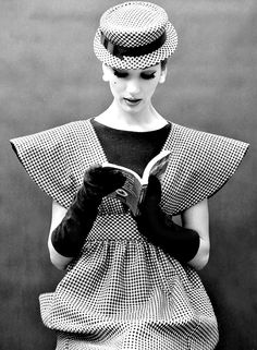 Simone D'Aillencourt reading in 1959 fashion.  D'Aillencourt is in a broad-shouldered pinafore of checks worn over a black sheath by Traina-Norell, photo by Nina Leen, 1959.  In 1941, Anthony Traina, a manufacturer of high-end clothing hired Norman Norell (1900-1972). Traina-Norell was celebrated for constructing ready-to-wear clothes which were on par with French couture.  With America cut off from French fashion due to WW II, Traina-Norell filled the gap and quickly rose to prominence.