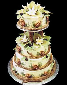 Love this woodland pinecones and flowers wedding cake - Mike's Amazing Cakes