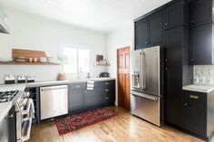 Blogger Ashley of Cherished Bliss uses CliqStudios black inset cabinetry to create a rustic and modern design.