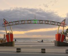 """Even the iconic """"Surfers Paradise"""" sign gets into the festive mood!  I captured this during my early morning walk to the beach for the sunrise..  #surfersparadise #surfersparadisebeach #cavillavenue #surfersparadisesign #iconic #goldcoast #goldcoastsunrise #christmaslights #christmas #christmas2015 #iphonesia #australia #queensland #holiday #bestoftheday #photooftheday #beach #insta_australia #instawow #instapic #morningwalk #sunrise #sunriselovers #sunrisehunter by chynna010…"""