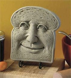 """Nice to be Kneaded"" Who wouldn't love this smiling slice of bread sculpture? Garden & Home Decor Sculptures Handmade by Carruth Studio, Waterville, OH"