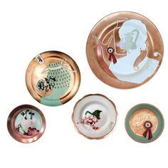 Shippo Plates A contemporary interpretation of an almost lost craft: 'shippo cloisonné' or 'enamel'. The piece not only reinterprets old decorations, but also employs untreated copper, which will eventually turn black /green.