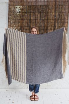 Warm, durable Belgian linen throws are perfect for cozy nights with family or friends. Soft and luxurious throw blankets in stripes and solids. Linen Towels, Guest Towels, Co2 Neutral, Vintage Blanket, Weaving Designs, Sofa, Bath Linens, Home Textile, Beach Towel