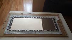 Cuadro con sobras de mosaicos espejo y carton