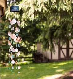 Make a Seashell Wind Chime from Empty Tin Cans  I'd wrap the can with rope.