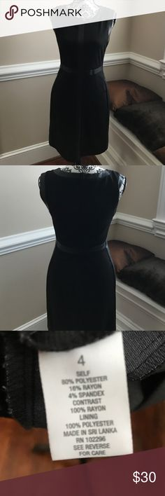 Dress with faux leather trim Fitted through the top and has faux leather accents along the edges of the dress. Has stretch in it so it fits comfortably. Only worn one time. roz and ali Dresses Midi