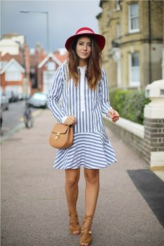 red hat with striped dress and satchel bag