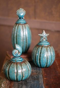 Set of Three Turquoise Ceramic Canisters with Oceanic Tops
