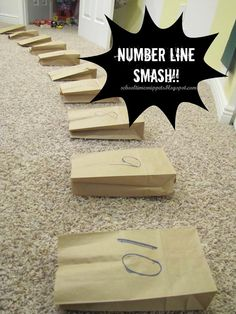 Use paper bags with numbers on the outside and open... kids then walk across them to solve addition or subtraction problems while smashing the bags.