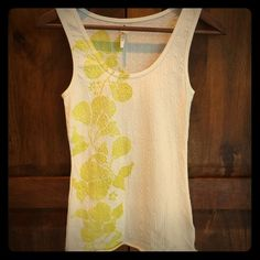 Free People tank Cute and soft white tank with olive green pattern. Perfect condition. Free People Tops Tank Tops