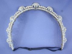 An art deco diamond and pearl 'halo' tiara, circa 1920s. Featuring nine diamond and large pearl motifs, set on a band of smaller pearls, possibly linked with Princess Alexandria of Yugoslavia, see next pin.