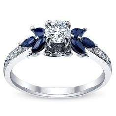 Would be cool if the sapphires went all the way around the diamond  rubies.work/ White Gold Diamond Engagement…