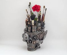 Steampunk Skull Organizer home decor Skull organizer made from the different parts and recyclable materials (metal, plastic, wood, glass). As a basis we use the plastic mask. With our accessories you can decorate your interior. Our items are unique. Height: 17cm Width: 14cm Length: 17cm weight is approx 800g An estimated shipping time is about 3 weeks. If you choose a fast delivery of write us your phone number. Follow us on Facebook for more info: https://www.facebook.co...