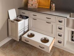 Who doesn't appreciate the quality and long-lasting finishes of Wood-Mode cabinetry? Take a look at this space they're now featuring… It's a dog wash station! How many times has your dog tried to walk into your house with muddy paws? Wouldn't this be perfect! And check out the food bins and feeding station, too!