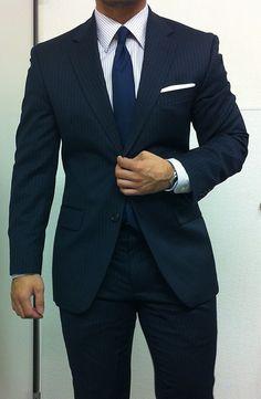 Blue suite, blue tie.