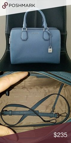 Michael Kors Mercer Duffle - NO TRADES.  -Gently used. Still have tags.  -Color is Denim.   -Interior: 4 pockets and 1 zipper pocket.   -Exterior: 2 side snap pockets. Michael Kors Bags Satchels