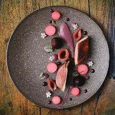 Honey lavender duck w/ red cabbage purée, beets, daikon, onions, wild raspberry, and cherry liquor by @alvinssto #TheArtOfPlating