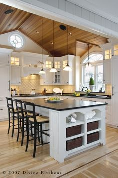 White kitchen with wood-tone ceiling