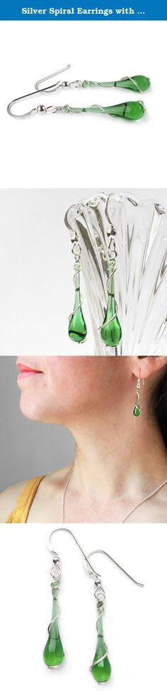 Silver Spiral Earrings with Recycled Emerald Green Teardrop. Silver Spiral Earrings These silver spiral earrings will quickly become your new favorites! A graceful spiral of silver twines around each vibrant emerald green drop of sun-melted glass, made from recycled ginger ale bottles. These silver spiral earrings are designed to make you feel elegant in every situations, from weekend casual to a night on the town. Argentium silver Chain and findings are solid sterling silver, so your...