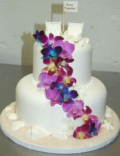 Okay, so I am totally digging the blue orchid right now for your wedding!  LOL  wedding 2 tier beach wedding cake blue cake inspiration ivory orchid ...