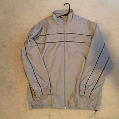 Nike jacket and pants set Gray like-new Nike jacket and pants, only wore it one time, perfect condition, men's but could fit a woman Nike Pants Track Pants & Joggers