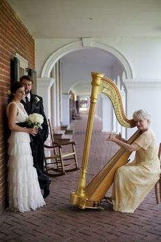 I'll be having Louisville's Renowned (not shown above) Lisa Spurlock playing the harp at our wedding.