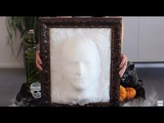 Make a single or a set of eerie ghost heads coming out of a frame. The technique is simply covering a form head with cheesecloth and spraying with starch.