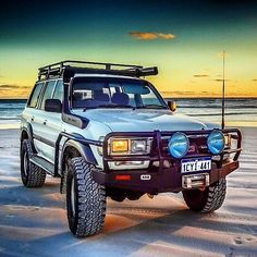 White Toyota 80 Series Land Cruiser on Beach with ARB Front Bumper, Snorkel, and Roof Rack Toyota 4x4, Toyota Trucks, Toyota Hilux, Land Cruiser Fj80, Toyota Land Cruiser, Landcruiser 80 Series, Best Off Road Vehicles, Off Road Adventure, Expedition Vehicle